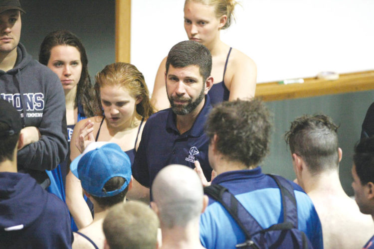 —Photo by Paul DeCoursey  Iowa Central head coach Joe Plane talks to the Triton swim team earlier this season. The Tritons will compete in the NJCAA naitonal meet starting today in Buffalo, N.Y.