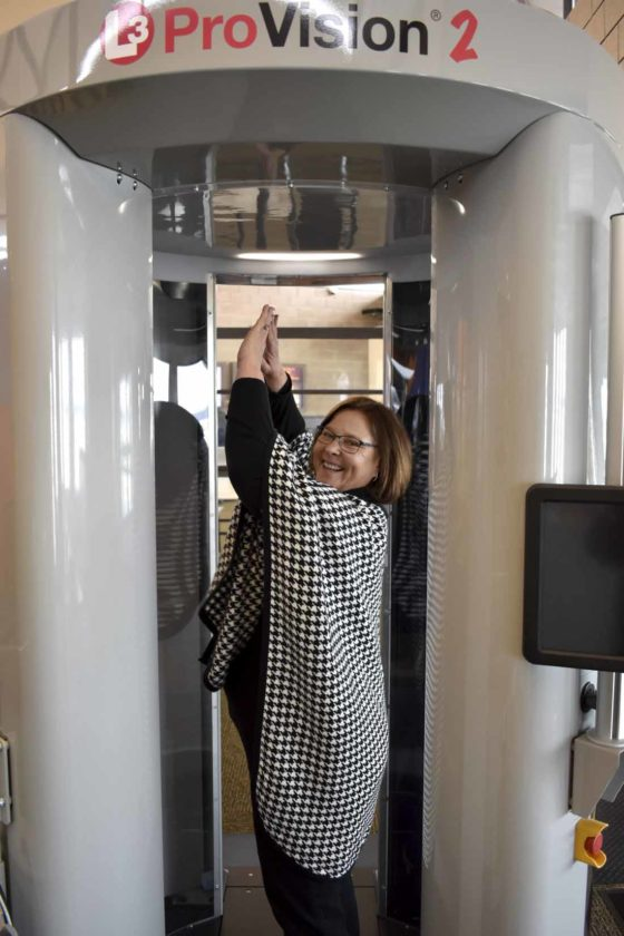 -Messenger photo by Chad Thompson  Rhonda Chambers, director of aviation, demonstrates how the new screening technology at the Fort Dodge Regional Airport is used.