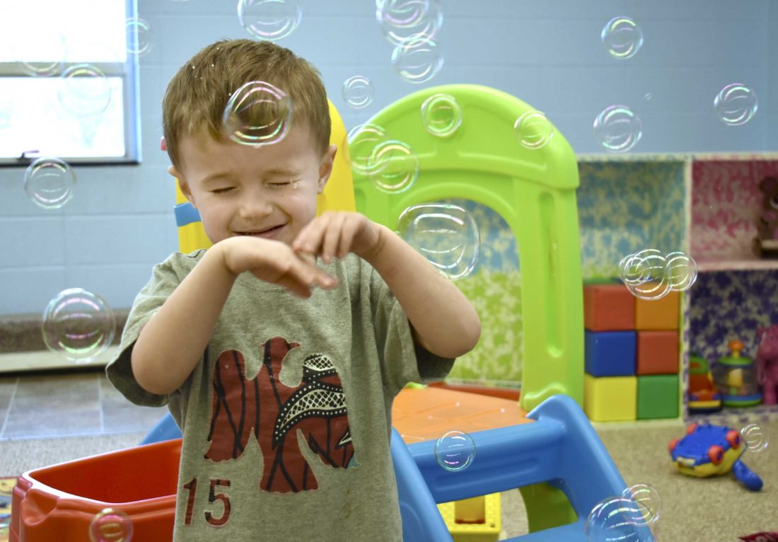 -Messenger photo by Chad Thompson  Tyson Banister, 2, has some bubble fun at the Gilmore City-Bradgate Child Care Center recently.