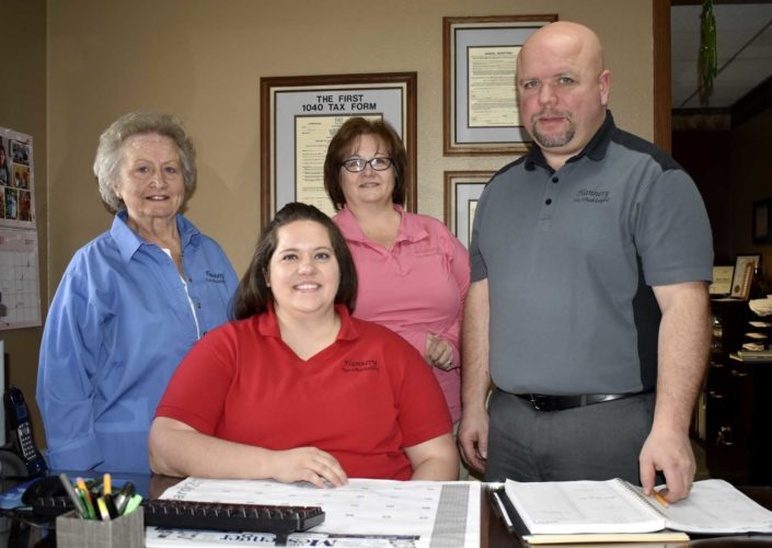 -Messenger photo by Chad Thompson  The Flannery-Salgren family is shown here at the office, located at 912 First Ave. N.. Back row from left to right: Marge Flannery, Kathy Flannery-Salrgren, and Wayne Salgren. Marisa Hamilton is shown in front.