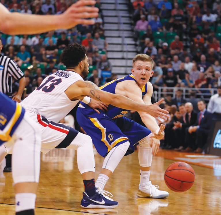 South Dakota State guard Reed Tellinghuisen (23) pass the ball past Gonzaga guard Josh Perkins (13) during the second half of a first-round men's college basketball in the NCAA Tournament Thursday, March 16, 2017, in Salt Lake City. Gonzaga defeated South Dakota State 66-46. (AP Photo/George Frey)