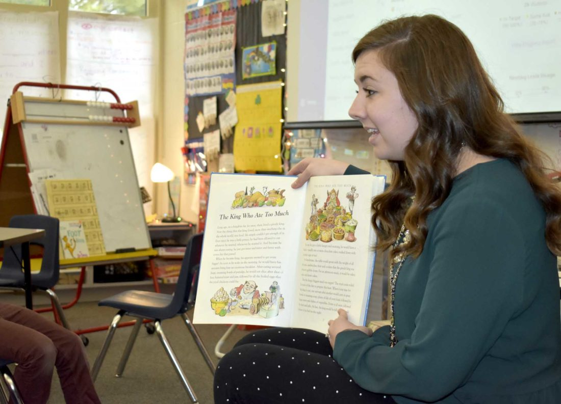 -Messenger photo by Chad ThompsonJenn Becker, a first grade teacher at Butler Elementary School, reads a book to her students before their recess at the school recently.