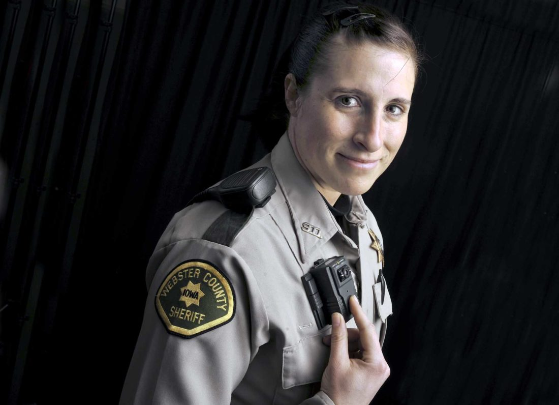 -Messenger photo by Hans Madsen  Webster County Sheriff's Deputy April Murray shows the button officers push to activate their body cameras while on patrol. The department recently got a camera for every road deputy. The cameras record audio and video of the deputies interactions with the public.