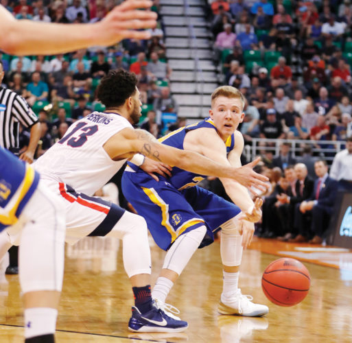 AP Photo  South Dakota State guard and East Sac County graduate Reed Tellinghuisen (23) passes the ball against Gonzaga during the NCAA Tournament.
