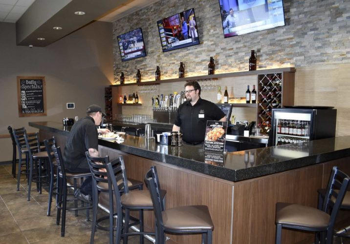 -Messenger photo by Chad Thompson  Dan DeWolf, bar manager, stands behind the bar inside the Hy-Vee Market Grille Express recently.
