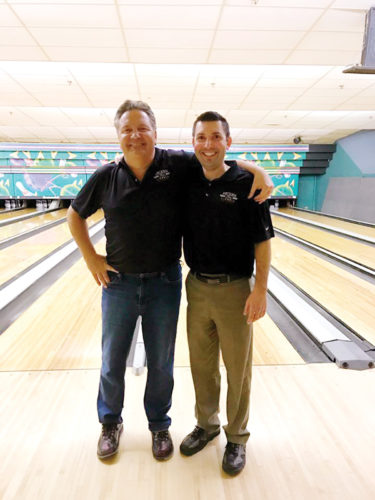 Submitted photo  The father-son duo of Casey and Matt Johnson stand together after both bowled perfect games on the same night at Ridgewood Lanes during the Fort Dodge Ford Classic League.