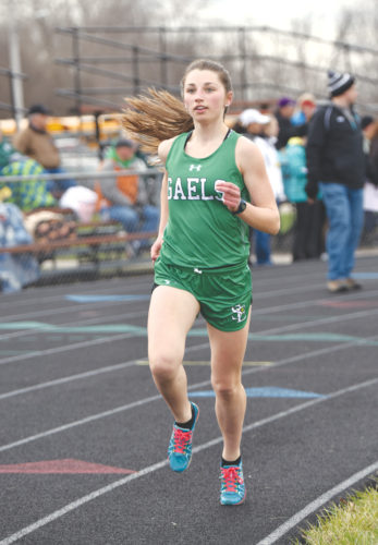 -Messenger photo by Britt Kudla Abby Landwehr of St. Edmond compete in the 3000 meter run during Southeast Valley Invitational on Tuesday