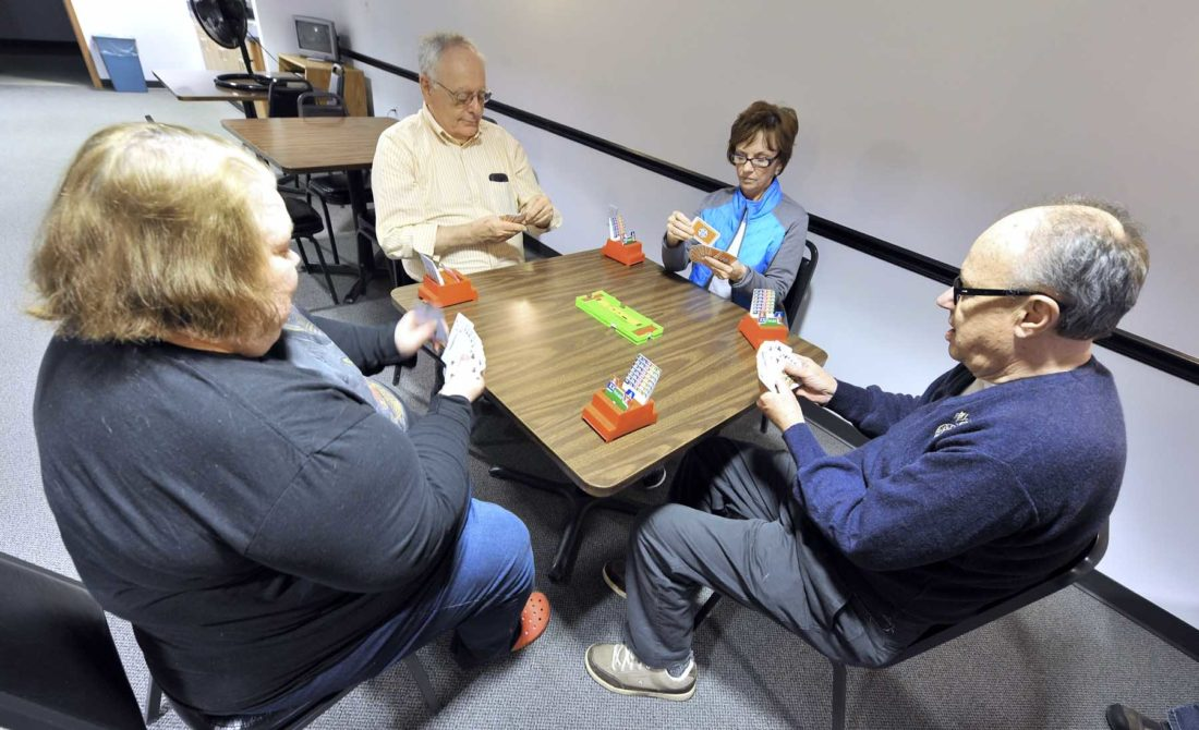 -Messenger photo by Hans Madsen  Tony Lennon, of Fort Dodge, at right, looks over his cards during a game of duplicate bridge with Eileen Carroll, at left, Larry Probst and Peggy Wyatt. The four are members of the Fort Dodge Duplicate Bridge Club which meets regularly at Citizens Central for games.