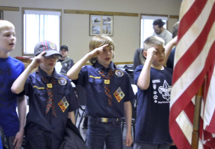 -Messenger photo by Joe Sutter  Drew Lundgren, left, Cole Lundgren, and Ian Brunner give the Cub Scout oath during a pack meeting in Dayton this week. A new Boy Scout troop is being formed for boys in the Southeast Valley school district for when they graduate up from Cub Scouts.