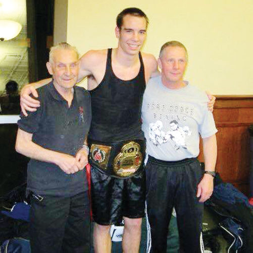 Submitted photo  Ron Walstrom of Fort Dodge (right)stands with Iowa Golden Gloves champion Martin Schuh (middle)and Fort Dodge Boxing Club owner Bud Fair in 2012.