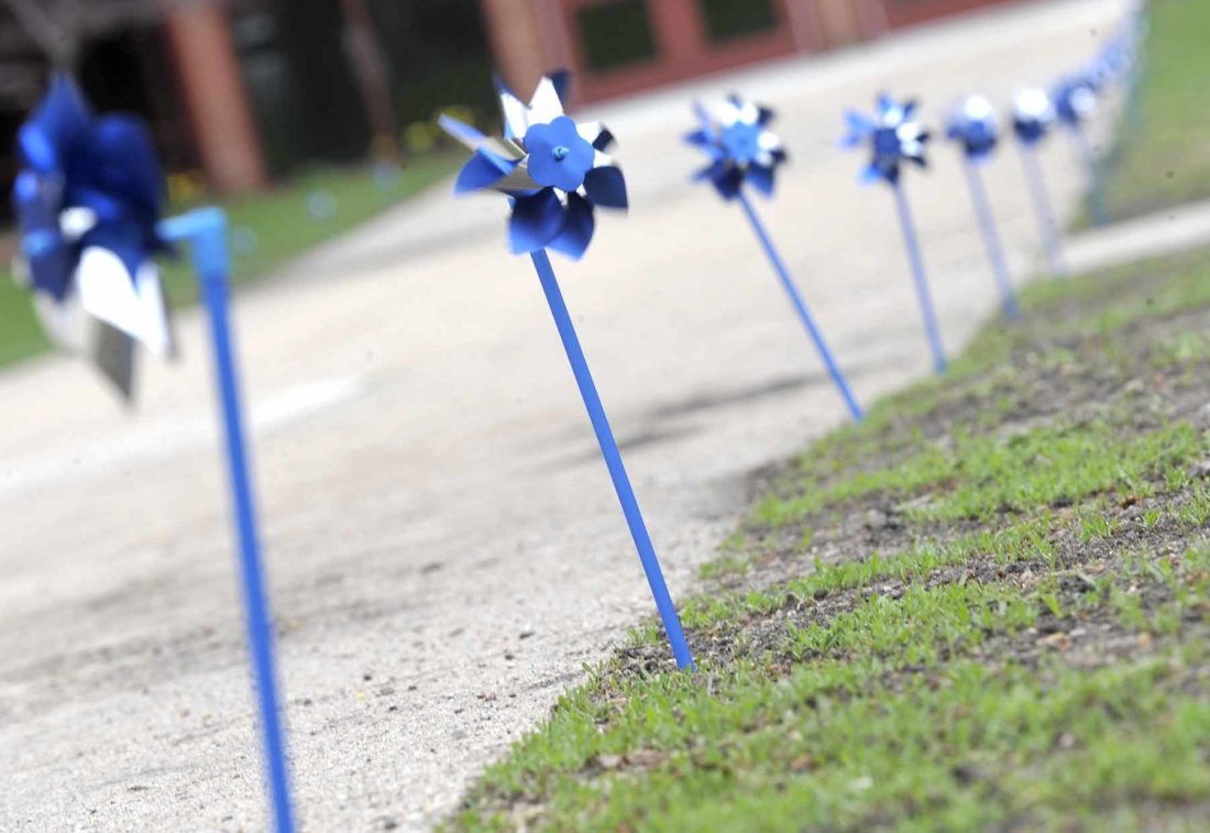 -Messenger photo by Hans MadsenPinwheels line the sidewalk at Cooper Elementary School Thursday morning to serve as a reminder of Child Abuse Prevention Month.