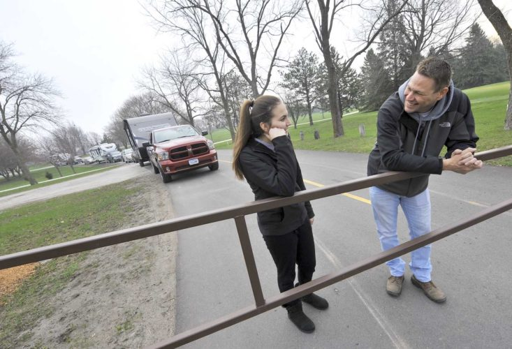 -Messenger photo by Hans Madsen  Jason Beckman, of Fort Dodge, and his daughter Shelbi Beckman, 14, wait patiently for the gates at the John F. Kennedy Memorial Park campground to be opened Friday morning. They were first in line and had arrived at 6 a.m.