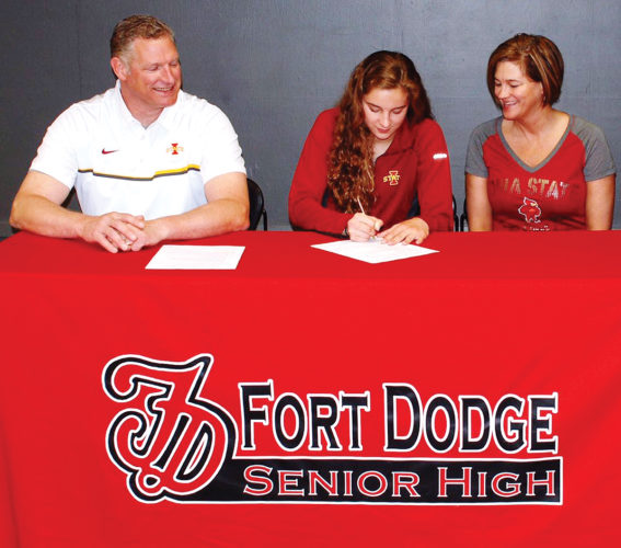 Submitted photo  Fort Dodge's Lehr Thorson signs her letter of intent to swim at Iowa State University with her father, Tjeran, and mother, Julie, at Fort Dodge Senior High.