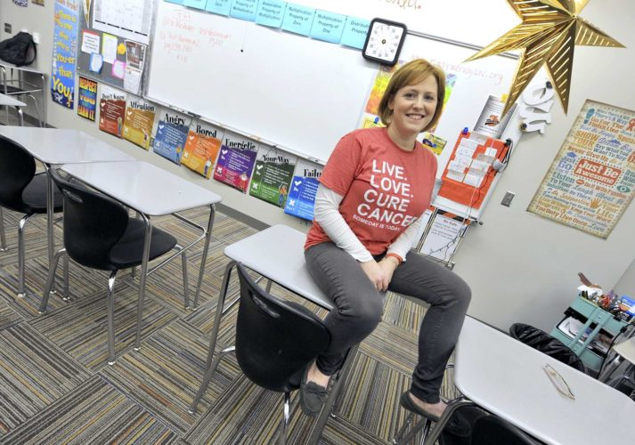 -Messenger photo by Hans Madsen  Wendy Daniel-Wiseman, of Fort Dodge, poses in her Fort Dodge Middle School classroom recently. Daniel-Wiseman is planning a series of fundraising events to raise money for the Leukemia & Lymphoma Society in the hope of becoming their Woman of the Year.