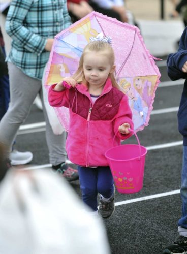 -Messenger photo by Hans Madsen  Sharilynn Peterson, 3, of Fort Dodge came well prepared for rain with her pink umbrella Saturday at the annual Moose Lodge Easter egg hunt in Dodger Stadium.