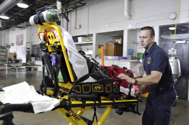 -Messenger photo by Peter Kaspari  Fort Dodge Firefighter/Paramedic Jason Reynolds prepares to load a stretcher back into Medic 8 at the fire station. Reynolds recently celebrated two years with the Fort Dodge Fire Department.