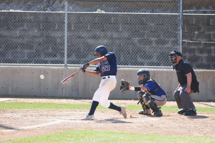 —Photo by Paul DeCoursey  Iowa Central's Rodny Rodriguez takes a swing at Ed Barbour Field on Monday.