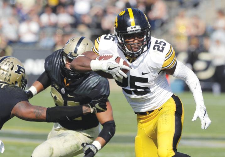 AP Photo  Iowa's Akrum Wadley runs the ball against Purdue in Lafayette, Ind. last season.