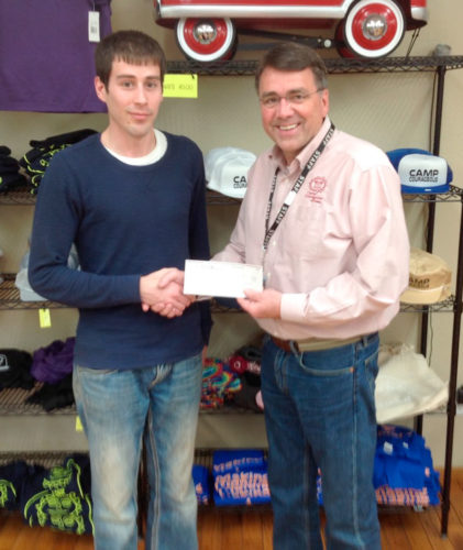 The Fort Dodge Knights of Columbus recently gave Camp Courageous a check for $1,000. Josh Bader and Charlie Becker, executive director of Camp Courageous, are pictured.