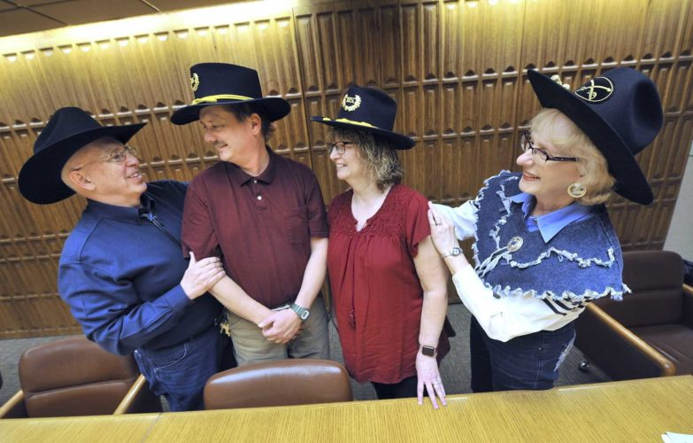 -Messenger photo by Hans Madsen  2012 Frontier Days Parade Marshalls Mike and Cindy Mulroney, at left and right, congratulate this year's parade marsharls, Tim and Kellie Guderian as they receive their hats Wednesday afternoon.