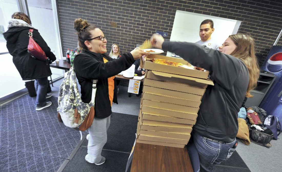 -Messenger photo by Hans Madsen  Iowa Central Community College student Danielle Rosalez, of Fort Dodge, earned four pieces of pizza Friday morning after she correctly identified four of her five First Amendment freedoms during a First Amendment Week event hosted by the Journalism and Digital Mass Media students. Student Hinda Moritz, of Okoboji, serves at right.