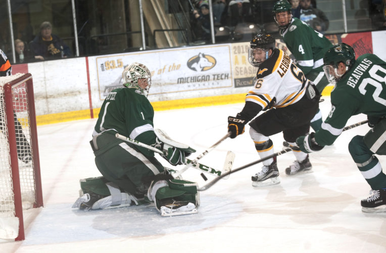 Daily Mining Gazette/David Archambeau Bemidji State's Michael Bitzer makes a save on Michigan Tech's Chad Leibinger Friday at the MacInnes Student Ice Arena.