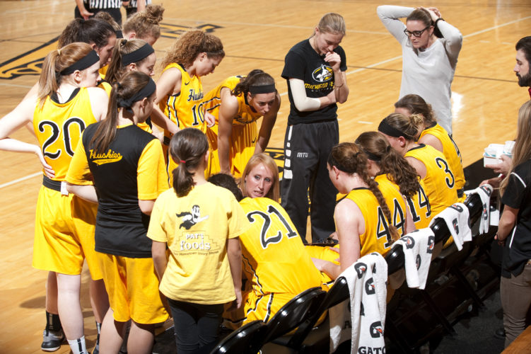 David Archambeau/Daily Mining Gazette Michigan Tech's Kim Cameron addresses her team during a timeout Saturday against Walsh at the Wood Gym.