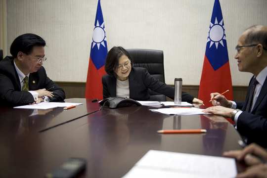 In this Friday, Dec. 2, 2016 photo released by Taiwan Presidential Office Saturday, Dec. 3, 2016, Taiwan's President Tsai Ing-wen, center, flanked by National Security Council Secretary-General Joseph Wu, left, and Foreign Minister David Lee, speaks with U.S. President-elect Donald Trump through a speaker phone in Taipei, Taiwan. (Taiwan Presidential Office via AP)
