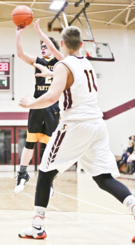 Jason Juno/Daily Globe Ewen-Trout Creek's Eli Nordine shoots during Monday night's game at Ontonagon. He scored 23 points off seven 3s for the Panthers.