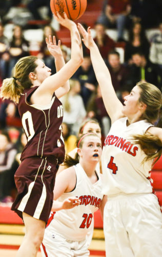 Jason Juno/Daily Globe Ontonagon's Fahren Kolpack, left, shoots over Wakefield-Marenisco's Darienne Kopri (4) during Tuesday's Copper Mountain Conference game at Wakefield.