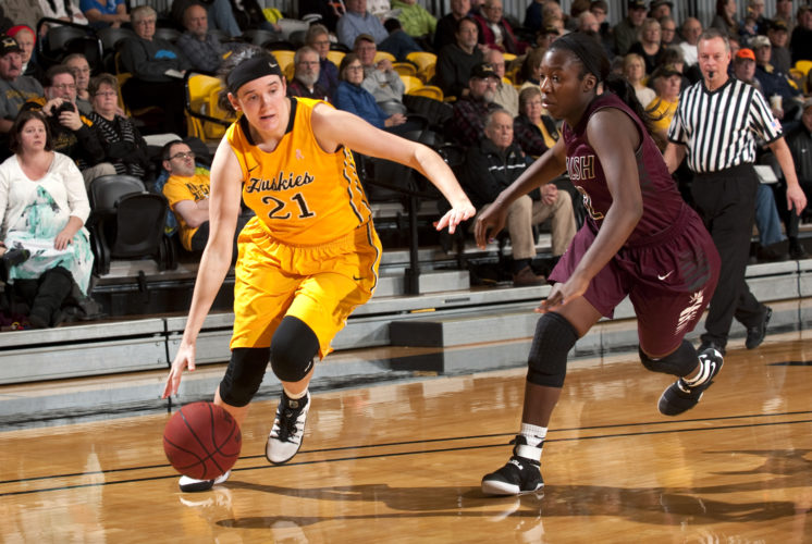 David Archambeau/Daily Mining Gazette Michigan Tech's Brenna Heise dribbles to the basket against Walsh Saturday at the Wood Gym. Tech plays at Lake Erie and Ohio Dominican this weekend.