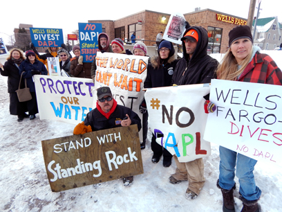 Vanessa Dietz/Daily Mining Gazette A group of protesters at Houghton's Wells Fargo Bank Thursday want the bank to withdraw its support of the Dakota Access Pipeline.