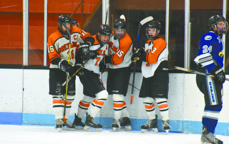 Daily Mining Gazette/Daver Karnosky Houghton's Jacob Kruse (16), Dawson McKay (7), Sam Raber (15), and Kevin Bostwick (3), celebrate a goal by McKay during the first period of a game against Utica Eisenhower Friday at Dee Stadium. The goal was the first of three by McKay in the game.