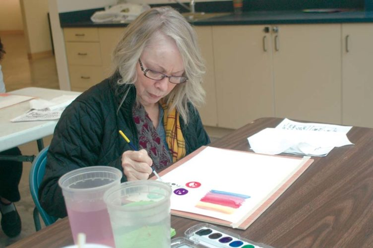 Mary Martello, of Marquette, practices watercolor painting Tuesday at a Senior Arts workshop at the Marquette Arts and Culture Center. Instructor Carl Mayer showed brush technique along with other ways to create unique art. (Journal photo by Christie Bleck)
