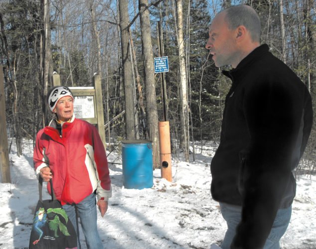 Deborah Ahlstedt and Tom Asmus, both of Marquette, discuss the Marquette Fit Strip. The two volunteer to keep the popular recreational site in good shape. (Journal photo by Christie Bleck)