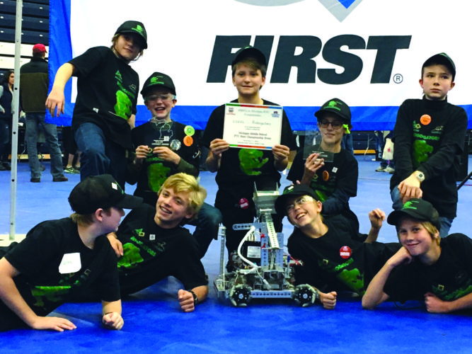 The Robogators team from North Star Academy show off their robot and recognition at the  recent FIRST Tech Challenge in  downstate Petoskey. Front row from left are Loyal Schneider, Torrey Cookman, Ezra Pickard and Sam Kinney. Back row from left are  Simon Barrett,  Seamus Waite,  Mason Doan, Emmett Claybaker and Cody Farwell. Not pictured is Jonny Johnson. (Photo courtesy of Laura Farwell)