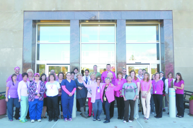 "The employees at the Oscar G. Johnson VA Medical Center in Iron Mountain and its community based VA clinics throughout the Upper Peninsula and northern Wisconsin recently observed Breast Cancer Awareness Month, which is observed each October.  VA employees wore pink on Oct. 18 to honor those women who have died from breast cancer and celebrate the survivors.  The medical center's Women's Wellness Clinic also sponsored a ""pink"" booth in the outpatient waiting area promoting awareness of breast cancer and early detection. ""As the population of women Veterans grows, the number being treated for breast cancer continues to increase,"" said Barbara Robinson, RN, Women Veterans Program Manager.  The Iron Mountain-based VA medical center consistently exceeds 90 percent each year in screening female patients ages 50-74 for breast cancer exceeding regional and national averages.  ""It is very important to us that our women Veterans get screened because when breast cancer is detected in its very early stage chances of a successful treatment are much higher,"" said Robinson. Localized breast cancer has a 99 percent survival rate if detected early, and VA leads the nation's health care systems in providing mammograms to those who need them.  The VA medical center and its community VA clinics annually serve over 1,300 women patients with clinically trained, gender specific health care providers.  The VA also provides comprehensive VA maternity care and services through local, non-VA providers. ""By having trained, gender-specific providers at the medical center and each of our community clinics we can offer our women Veterans comprehensive care in a single visit,"" said Robinson. For more photos of employees wearing pink, please visit the Oscar G. Johnson VAMC Facebook page."