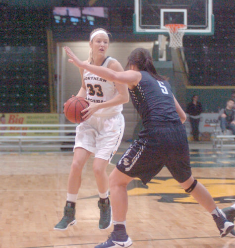 NMU's Tess Weatherly looks for an open Wildcat in the paint with Concordia's Kyrah Frendenburg guarding her during the second half of their match on Friday, Nov. 18 at the Berry Events Center in Marquette. (Journal photo by Ray Bressette)