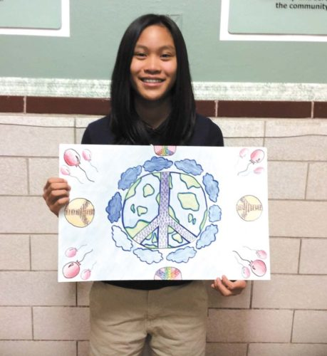 "The Marquette Lions Club sponsored the Lions International Peace Poster contest at Father Marquette Middle School this year. The theme was ""A Celebration of Peace."" Pictured is local winner, Maria Millado.  Her poster will now go on to further judging at the District level and if she wins there, on to International."
