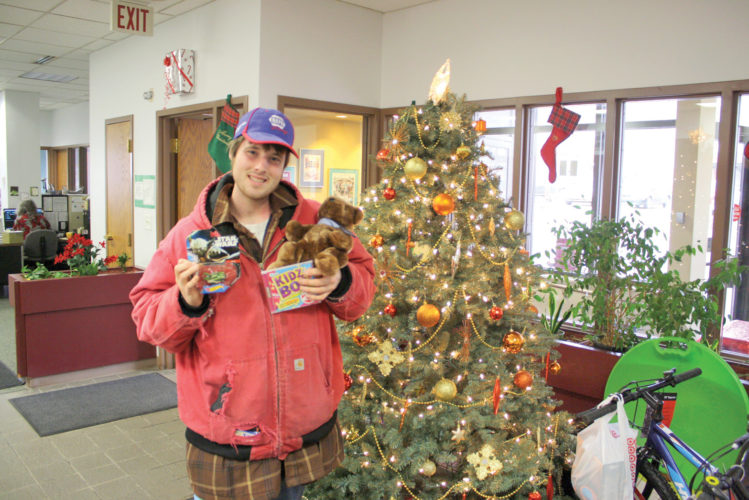 Cory Hambleton, of Marquette, drops off toys Tuesday at The Mining Journal's Marquette office for this year's Cheer Club. The Cheer Club is a joint effort between the Journal, the Salvation Army and St. Vincent de Paul to provide gifts to local children and families in need for Christmas. Unwrapped toys and other items for children up to age 14 can be dropped off at the Journal's Marquette and Ishpeming offices, the Marquette and Ishpeming Salvation Army locations and the St. Vincent de Paul in Marquette. (Journal photo by Ryan Jarvi)