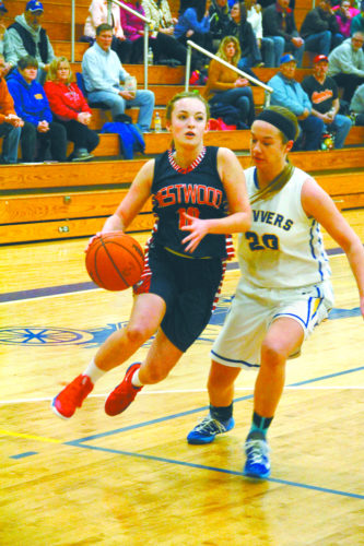 Westwood's Madelyn Koski, left, dribbles past Kingsford's Hannah Carlson on Friday,  in Kingsford. (Iron Mountain Daily News by Adam Niemi).
