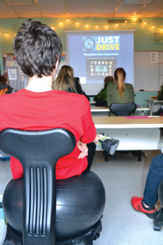 Marquette City Police Department Youth Services Officer Craig Marker presents to teacher Lucy Anthony's ninth-grade lifetime health class Friday at the Marquette Senior High School. (Journal photo by Kelsie Thompson)