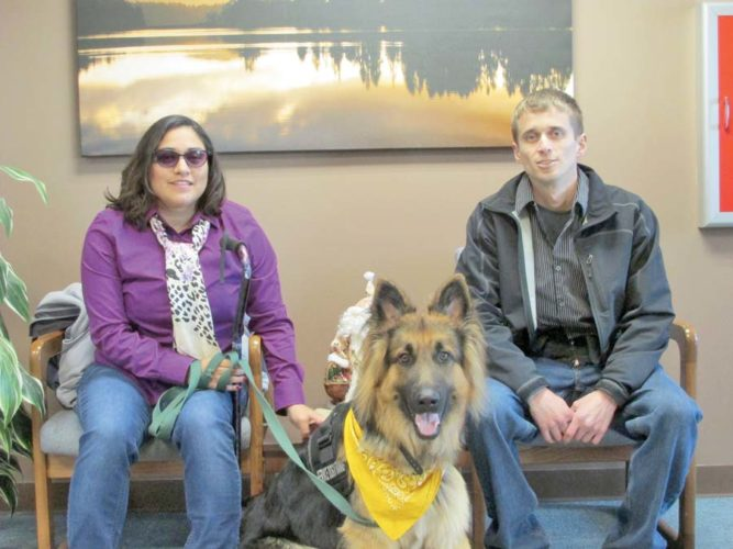 Veterans Katie and Andrew Stemen pose in the office at the Presque Isle Power Plant with Katie's new service dog, Stryker, who is a gift from the We Energies Employe's Mutual Benefit Association. U.S. Army Sgt. Katie Stemen suffered traumatic brain injuries while serving overseas in Iraq and Afghanistan. Stryker will help her regain independence. (Journal photo by Mary Wardell)