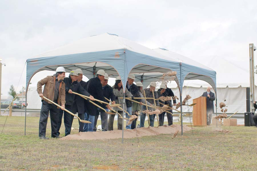 "Members of the Keweenaw Bay Indian Community Tribal Council line up during a Tuesday ceremony to ""break the ground,"" signifying the first day of construction of a project to expand the Ojibwa Casino in Chocolay Township. General Manager Don Wren, right, smiles from the podium. (Journal photo by Rachel Oakley)"