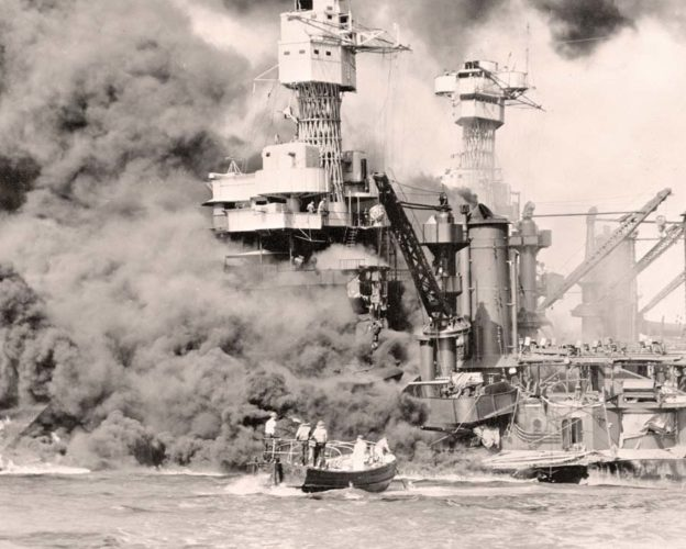 A small boat rescues a seaman from the USS West Virginia burning in the foreground in Pearl Harbor, Hawaii, after the Japanese attack, 75 years ago today. (AP photo)
