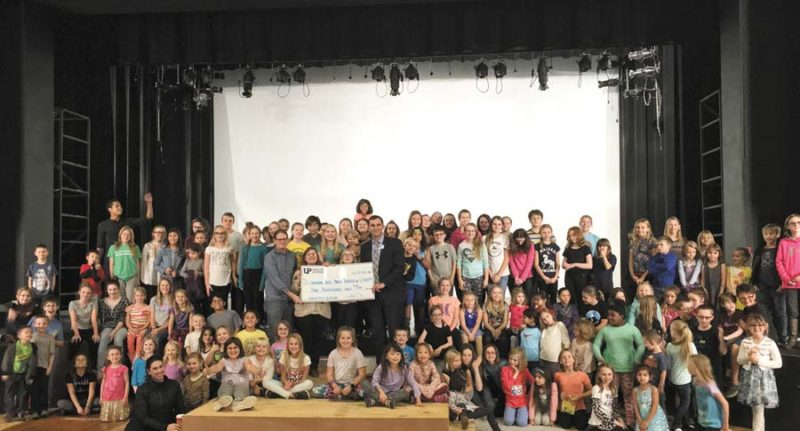 """UPHealth System-Marquette makes donation to Superior Arts Youth Theater: UP Health System-Marquette has made a $1,000 donation to the Superior Arts Youth Theater, a local non-profit organization which promotes youth engagement with the dramatic arts. Victor Harrington, regional director of Marketing and Business Development, said, """"UP Health System-Marquette is committed to the health and well-being of our community and is proud to sponsor the Superior Arts Youth Theater."""" The Superior Arts Youth Theater traces its history in Marquette back to 1992, when the city contracted an Arts & Culture coordinator, which led to the creation of the Arts and Culture Department in 1995. In 2002, the city of Marquette hired Nikke Nason as the Arts Education director. Nason became the executive artistic director of the youth theater and Lake Superior Theater in 2013."""