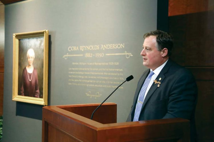 State Rep. Scott Dianda, D-Calumet, speaks Thursday at the unveiling of a new portrait of Cora Reynolds Anderson, Michigan's first female and first Native American state representative, at the House Office Building in Lansing, which is named in her honor. Anderson represented Baraga, Iron, Keweenaw and Ontonagon counties from 1925-26. (Courtesy photo)