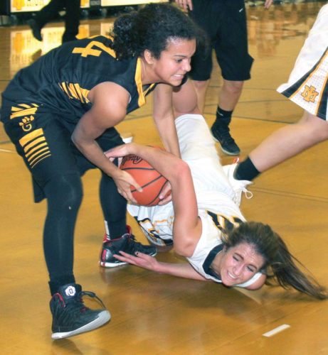 Gwinn's Kia Evans, top, and Iron Mountain's Brianna Hoffman wrestle for the ball during their high school girls basketball game played at the Mountaineers gym on Thursday. (Iron Mountain Daily News photo by Theresa Proudfit)