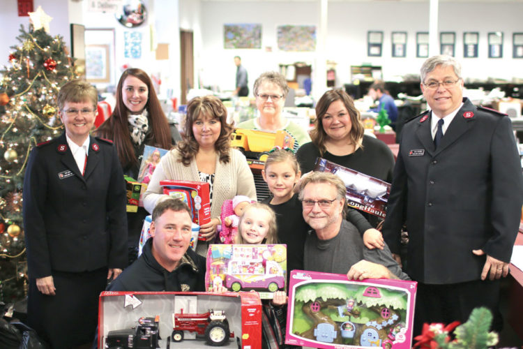 Commemorative Bucks of Michigan have made the biggest donation to cheer club yet, hauling in eleven large bags full of hundreds of toys for children in need. They met with Capts. Kim and Doug Winters of the Salvation Army at the Mining Journal to deliver their gifts. From left in the back row is Capt. Kim Winters, Amanda Goodman, Laurie Goodman, Terry Paveglio, Jamie Curtis, and Capt. Doug Winters. From left in front is Kevin Goodman, Ainsley Kargela, Keira Limdberg, and Jim Curtis. The Cheer Club is a joint effort between the Journal, the Salvation Army and St. Vincent de Paul to provide gifts to local children and families in need for Christmas. Unwrapped toys and other items for children up to age 14 can be dropped off at the Journal's Marquette and Ishpeming offices, the Marquette and Ishpeming Salvation Army locations and the St. Vincent de Paul in Marquette. (Journal photo by Rachel Oakley)