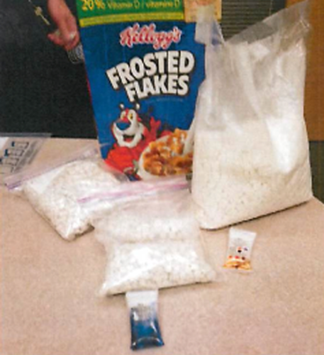 About 6.5 pounds of drugs, shown above, were hidden inside a Kellogg's Frosted Flakes box. Photo via Homeland Security Investigations.
